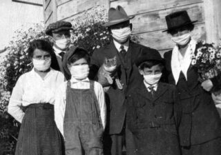 family photo of six people plus cat from the 1918 flu pandemic